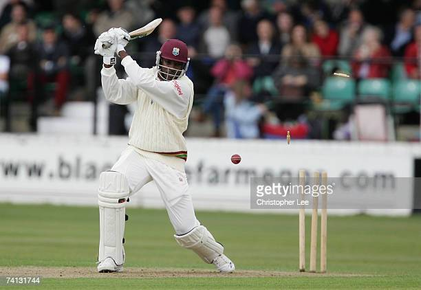 The bails fly after Chris Gayle of West Indies mistimes his shot and loses his wicket during the West Indies Tour Warmup match between Somerset CCC v...