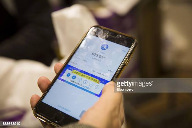 The balance amount of a customer is displayed on the Ant Financial Services Group's Alipay app an affiliate of Alibaba Group Holding Ltd at a Takeya...