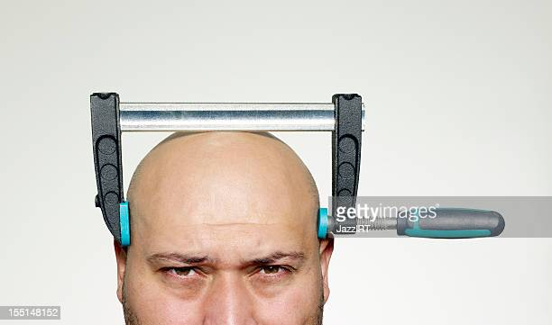 The bald man head with screw clamp compressed