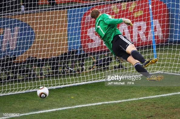 The ball bounces over the line past goalkeeper Manuel Neuer of Germany as England are denied the goal decision during the 2010 FIFA World Cup South...