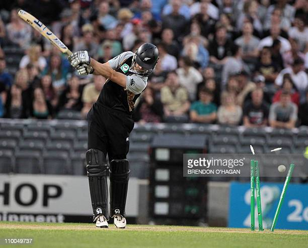 The ball bowled by Pakistan bowler Abdul Razzaq smashes the wicket sending New Zealand batsman James Franklin out for 3 runs during their third...