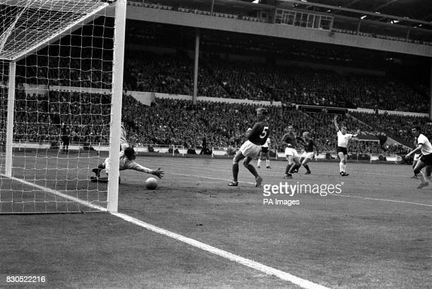 The ball eludes the clutching hands of England goalkeeper Gordon Banks and goes into the net to give West Germany a 10 lead after 13 minutes in the...