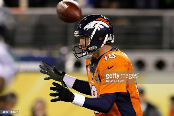 The ball flies over the head of quarterback Peyton Manning of the Denver Broncos in the first quarter against the Seattle Seahawks during Super Bowl...