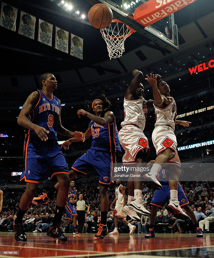 The ball gets away from Jonathan Bender #9 and Jordan Hill #43 of the New York Knicks as well as Chris Richard #35 and James Johnson #16 of the Chicago Bulls at the United Center on February 16, 2010 in Chicago, Illinois. The Bulls defeated the Knicks 118-85.
