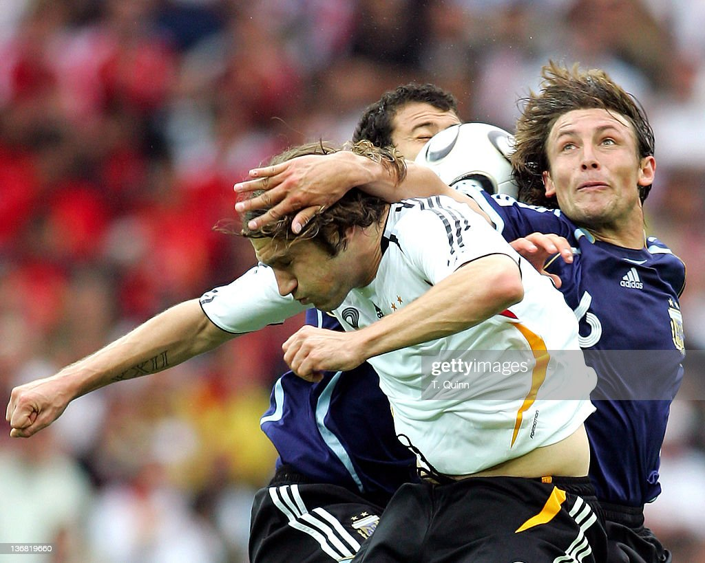 The ball gets caught between Torsten Frings of Germany and <a gi-track='captionPersonalityLinkClicked' href=/galleries/search?phrase=Gabriel+Heinze&family=editorial&specificpeople=202858 ng-click='$event.stopPropagation()'>Gabriel Heinze</a> and Juan Riquelme of Argentina during their quarterfinal match at the Olympiastadion in Berlin, Germany on June 30, 2006. Germany passed through to the semifinals with a 4-2 win in penalty kicks over Argentina (1-1 in regular time).