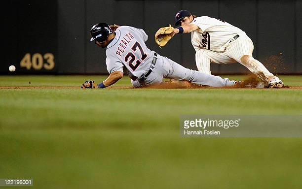 The ball gets past Trevor Plouffe of the Minnesota Twins on an attempt to catch Jhonny Peralta of the Detroit Tigers stealing in the eighth inning on...