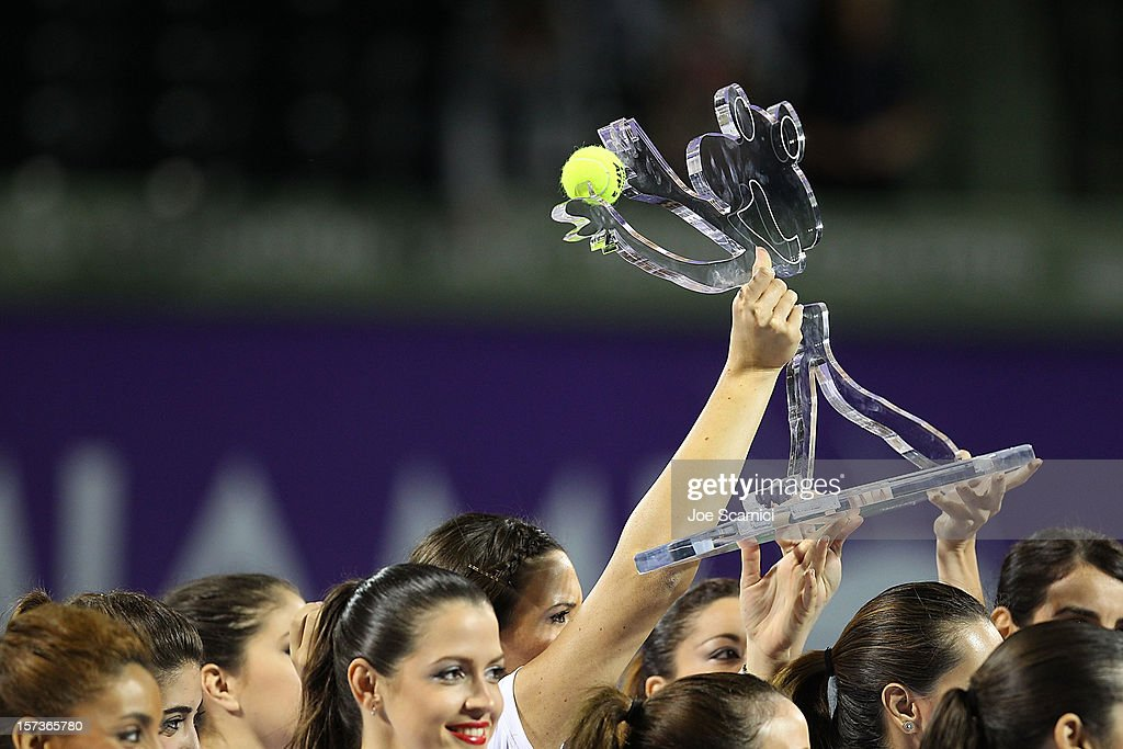 The ball girls lift up the winners trophy during the Miami Tennis Cup at Crandon Park Tennis Center on December 2, 2012 in Key Biscayne, Florida.