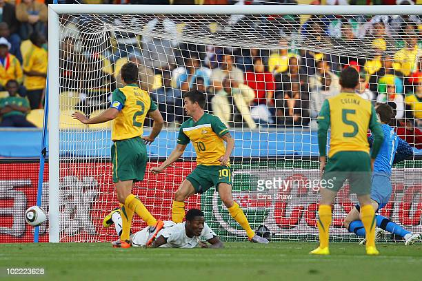 The ball hits Harry Kewell of Australia on the chest and arm and referee Roberto Rosetti sends him off and awards Ghana a penalty during the 2010...