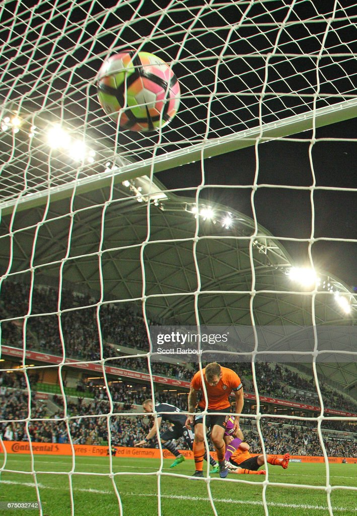 The ball hits the back of the net as Besart Berisha of the Victory celebrates as he scores the winning goal during the A-League Semi Final match between Melbourne Victory and the Brisbane Roar at AAMI Park on April 30, 2017 in Melbourne, Australia.