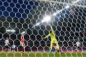 TOPSHOT The ball hits the crossbar as Switzerland's goalkeeper Yann Sommer jumps for it during the Euro 2016 group A football match between...
