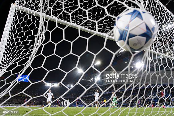 The ball hits the next after Basel's Swiss forward Breel Embolo scored the team's second goal during the UEFA Champions League playoff football match...