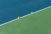 Tennis ball on the field line meaning it is not out
