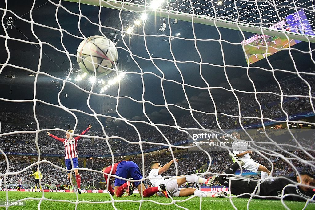 The ball is seen in the net as Atletico Madrid's Belgian forward Yannick Ferreira Carrasco scored a goal during the UEFA Champions League final football match between Real Madrid and Atletico Madrid at San Siro Stadium in Milan, on May 28, 2016. / AFP / PIERRE