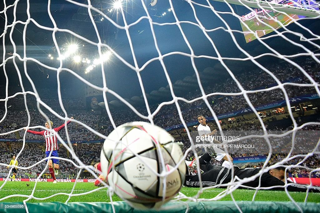 The ball is seen in the net as Atletico Madrid's Belgian forward Yannick Ferreira Carrasco (unseen) scored a goal during the UEFA Champions League final football match between Real Madrid and Atletico Madrid at San Siro Stadium in Milan, on May 28, 2016. / AFP / PIERRE