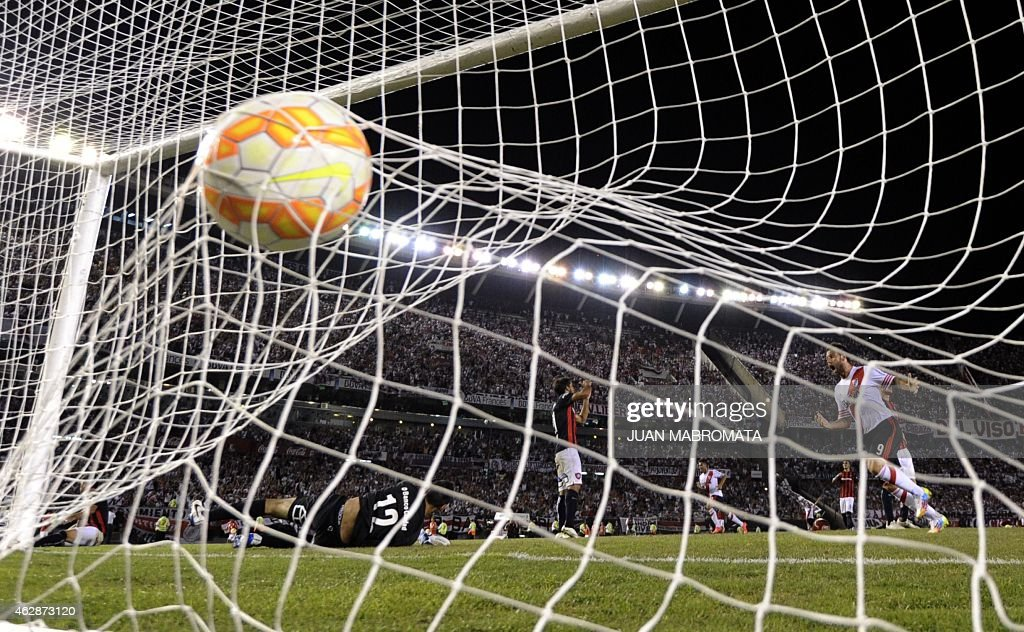 The ball reaches the net after River Plate's midfielder Carlos Sanchez scores a goal against San Lorenzo during the Recopa Sudamericana 2015 first...