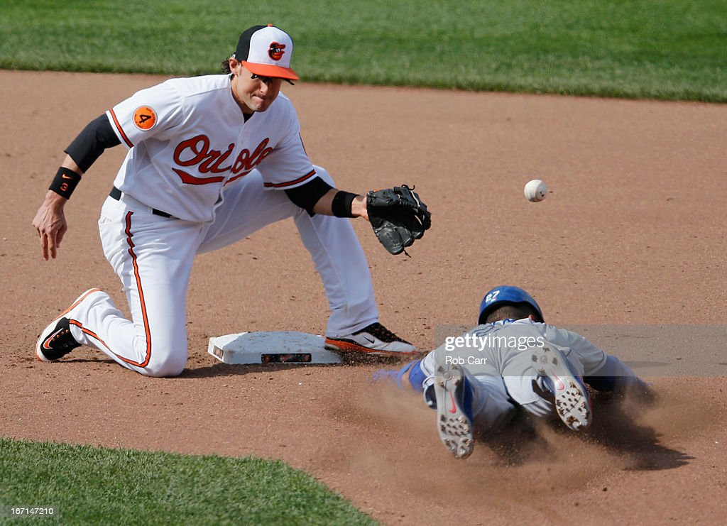 The ball sails past Ryan Flaherty #3 of the Baltimore Orioles as <a gi-track='captionPersonalityLinkClicked' href=/galleries/search?phrase=Matt+Kemp&family=editorial&specificpeople=567161 ng-click='$event.stopPropagation()'>Matt Kemp</a> #27 of the Los Angeles Dodgers steals second base during the seventh inning of the Dodgers 7-4 win at Oriole Park at Camden Yards on April 21, 2013 in Baltimore, Maryland.