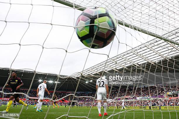 The ball slams into the back of the net after Manchester City's Argentinian striker Sergio Aguero scored his first goal during the English Premier...