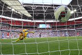 The ball slams into the back of the net as Arsenal's French striker Olivier Giroud scores their third goal in the FA Community Shield football match...