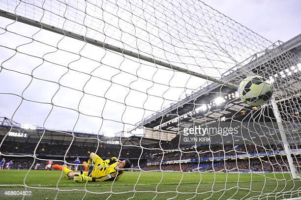 The ball slams into the back of the net as Chelsea's Belgian goalkeeper Thibaut Courtois falls into his own goal after chasing back but failing to...