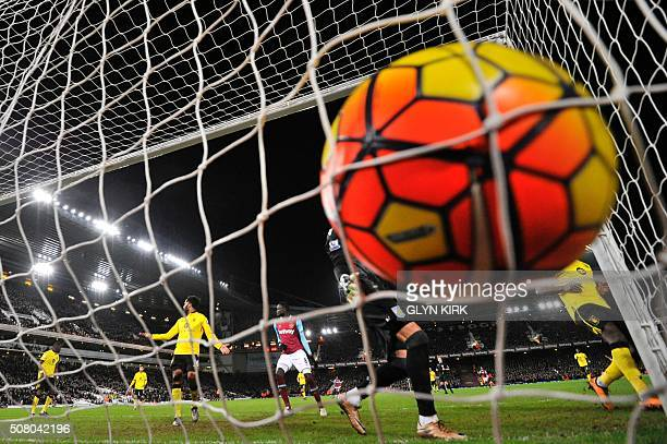 TOPSHOT The ball slams into the back of the net for West Ham's first goal scored by West Ham United's English midfielder Michail Antonio during the...