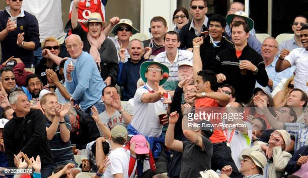 The ball smashes into a spectators plastic beer glass after a six was hit by India's Praveen Kumar off the bowling of England's Graeme Swann during...