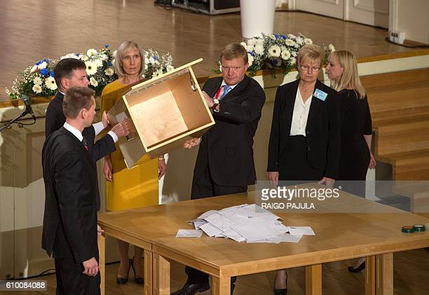 The ballot box is emptied on a table during the Estonian presidential elections in Tallinn on September 24 2016 Estonia's electoral college meets to...