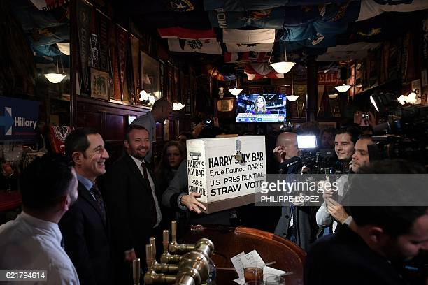 The ballot box of Harry's New York Bar is about to be open in Paris late on November 8 2016 during a straw vote for US citizens living in France...