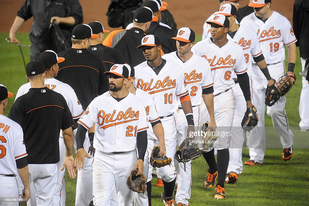 The Baltimore Orioles celebrate a win after a baseball game against the Boston Red Sox on June 11, 2014 at Oriole Park at Camden Yards in Baltimore, Maryland. The Orioles won 6-0.