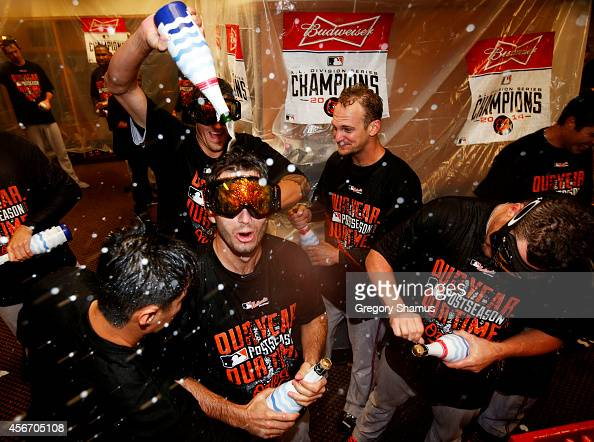 The Baltimore Orioles celebrate in the locker room after their 2 to 1 win over the Detroit Tigers to sweep the series in Game Three of the American...