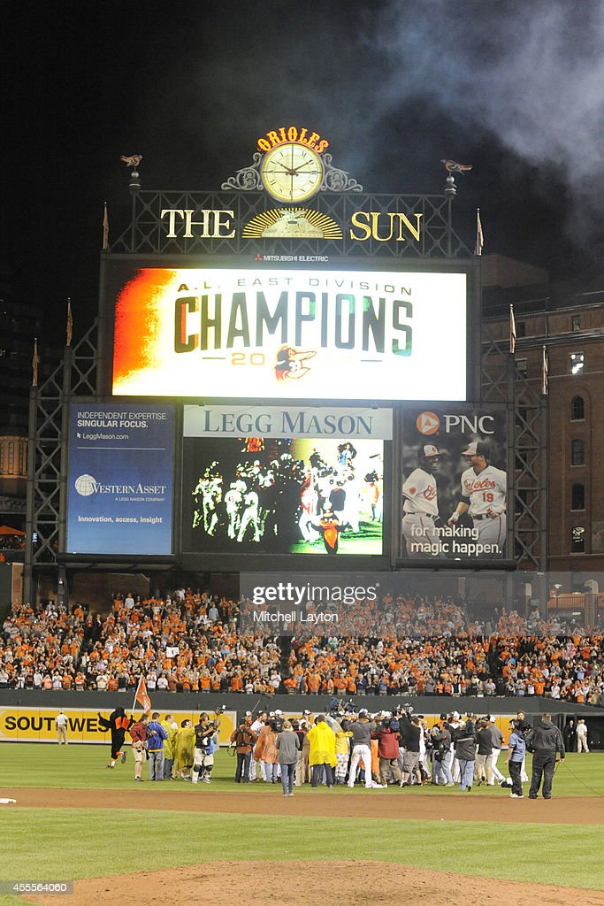 The Baltimore Orioles celebrate on the field after the Orioles clinch the American League East Division during a baseball game against the Toronto Blue Jays on September 16, 2014 at Oriole Park at Camden Yards in Baltimore, Maryland.