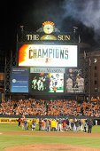 The Baltimore Orioles celebrate on the field after the Orioles clinch the American League East Division during a baseball game against the Toronto...