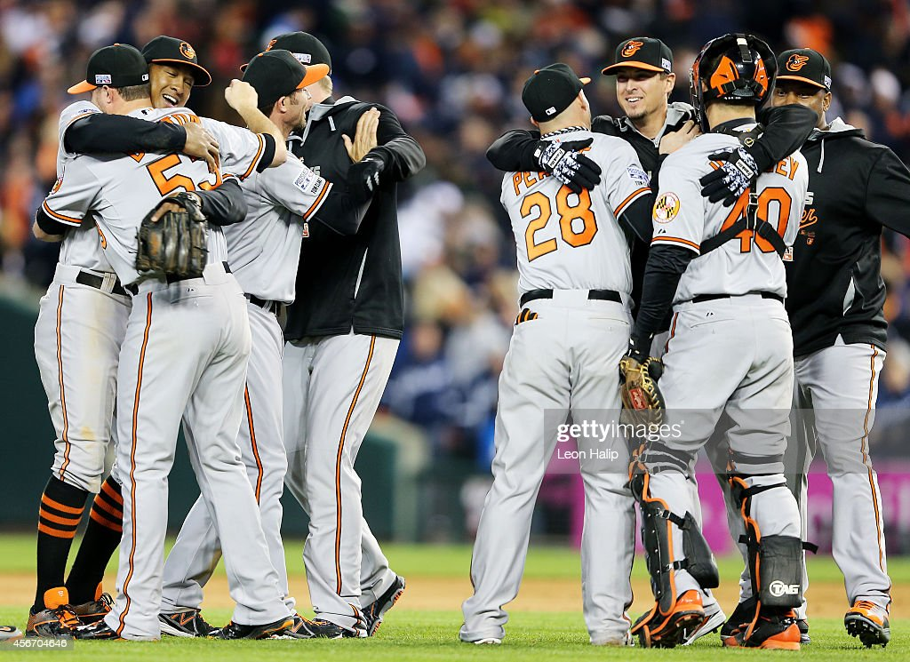 The Baltimore Orioles celebrate their 2 to 1 win over the Detroit Tigers to sweep the series in Game Three of the American League Division Series at...