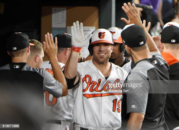 The Baltimore Orioles' Chris Davis celebrates in the dugout after hitting a grand slam against the Texas Rangers in the fourth inning at Oriole Park...