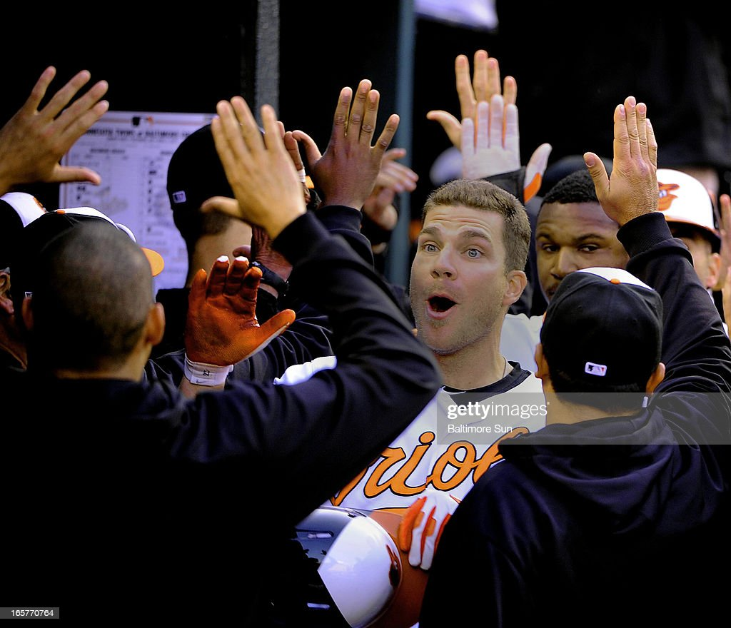 The Baltimore Orioles' Chris Davis celebrates with teammates after his grand slam home run in the eighth inning against the Minnesota Twins at Oriole Park at Camden Yards in Baltimore, Maryland, Friday, 5, 2013. The Orioles defeated the Twins 9-5.