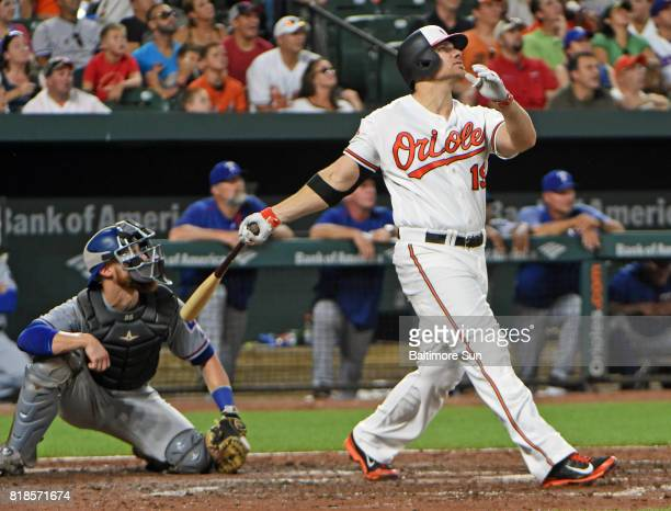 The Baltimore Orioles' Chris Davis watches his grand slam clear the centerfield wall against the Texas Rangers in the fourth inning at Oriole Park at...