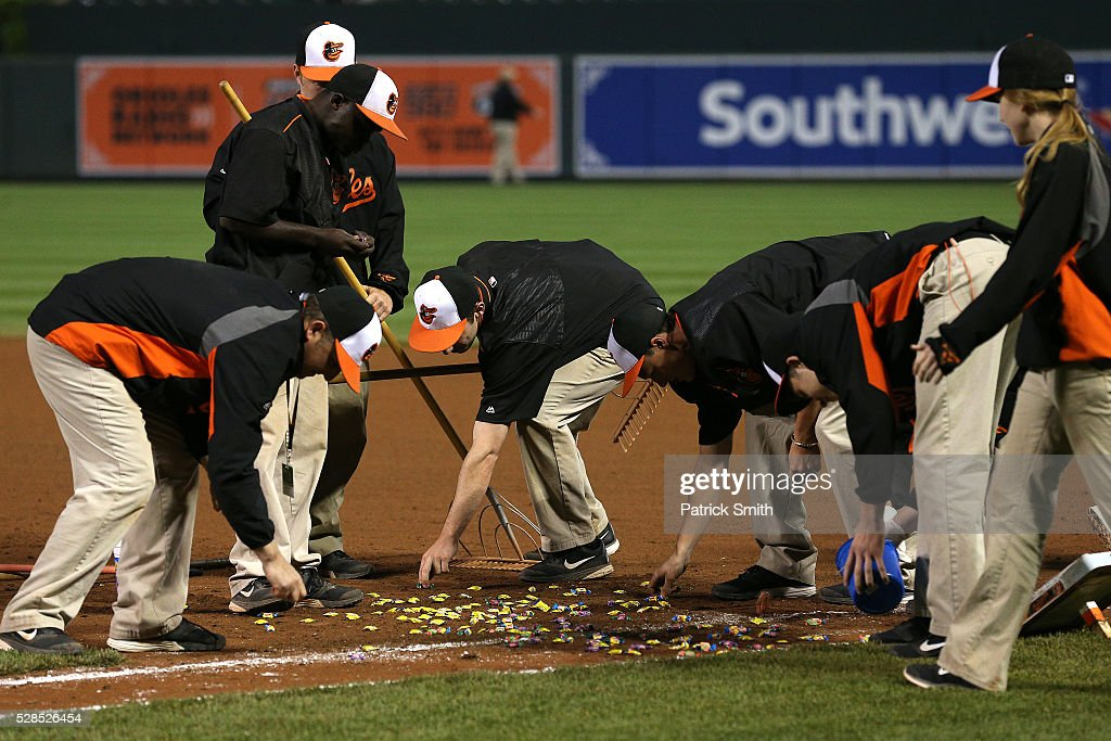 The Baltimore Orioles grounds crew picks up gum after the Baltimore Orioles defeated the New York Yankees at Oriole Park at Camden Yards on May 5, 2016 in Baltimore, Maryland. The Baltimore Orioles won, 1-0, in the tenth inning.