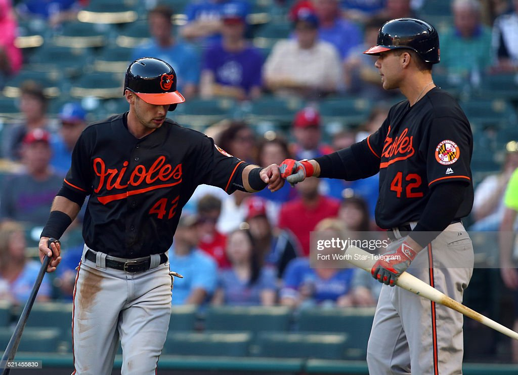 The Baltimore Orioles Joey Rickard, left, fist-bumps teammate <a gi-track='captionPersonalityLinkClicked' href=/galleries/search?phrase=Chris+Davis+-+Baseball+-+Texas+Rangers&family=editorial&specificpeople=7129264 ng-click='$event.stopPropagation()'>Chris Davis</a> after scoring in the first inning against the Texas Rangers at Globe Life Park in Arlington, Texas, on Friday, April 15, 2016.