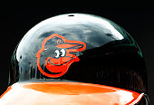 The Baltimore Orioles logo is seen on a batting helmet during the game between the Boston Red Sox and the Baltimore Orioles at Fenway Park on June 25...