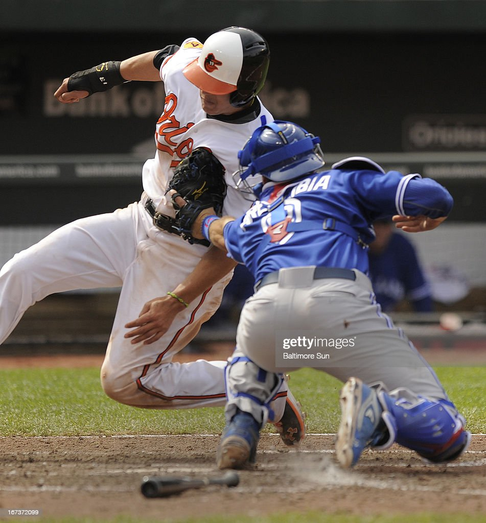 The Baltimore Orioles' Manny Machado, left, is tagged out at home by Toronto Blue Jays catcher J.P. Arencibia to end the 10th inning at Camden Yards in Baltimore, Maryland, on Wednesday, April 23, 2013. Toronto won, 6-5, in 11 innings.