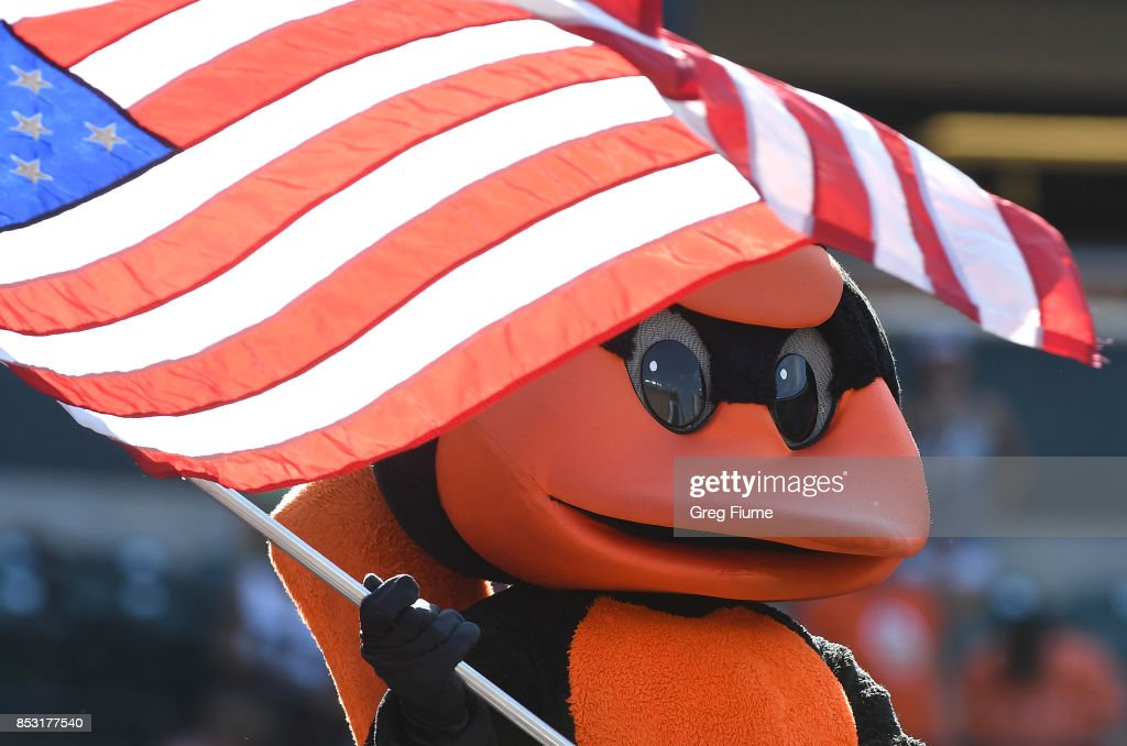 The Baltimore Orioles mascot waves the American Flag during the seventh inning stretch against the Tampa Bay Rays at Oriole Park at Camden Yards on September 24, 2017 in Baltimore, Maryland.