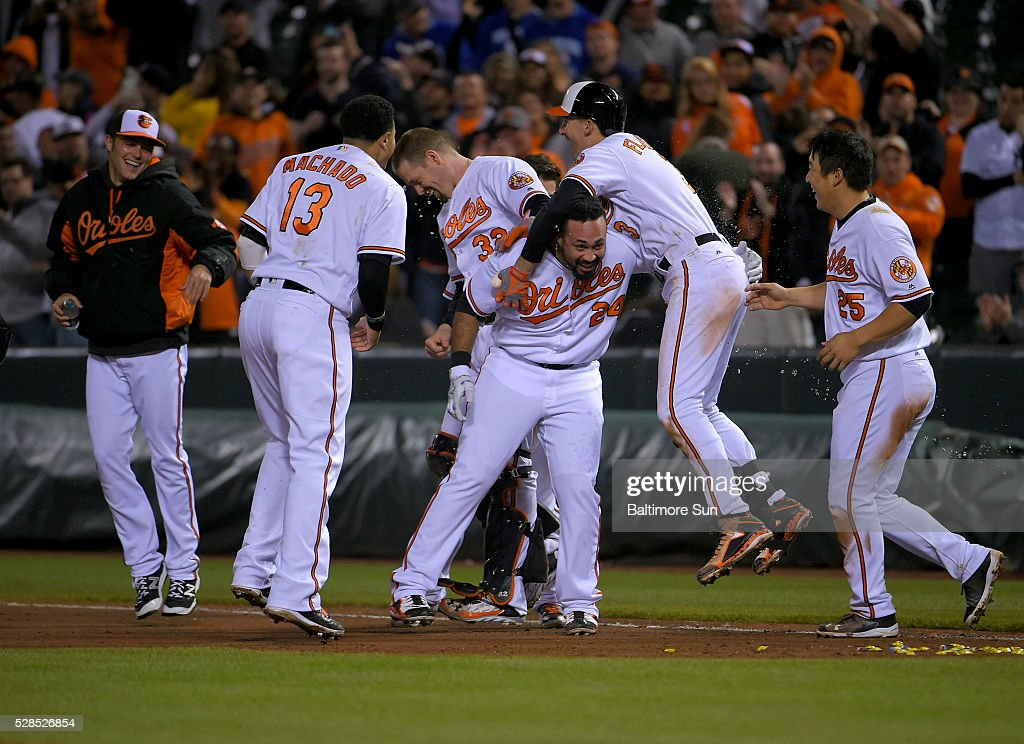 The Baltimore Orioles mob designated hitter Pedro Alvarez, whose sacrifice fly plated the game's only run in the 10th inning against the New York Yankees at Oriole Park at Camden Yards in Baltimore on Thursday, May 5, 2016.