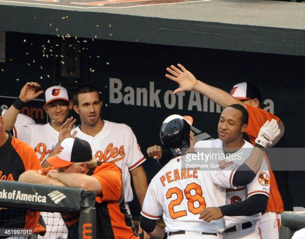 The Baltimore Orioles' Steve Pearce is welcomed back into the dugout after a solo home run in the first inning against the Washington Nationals at...