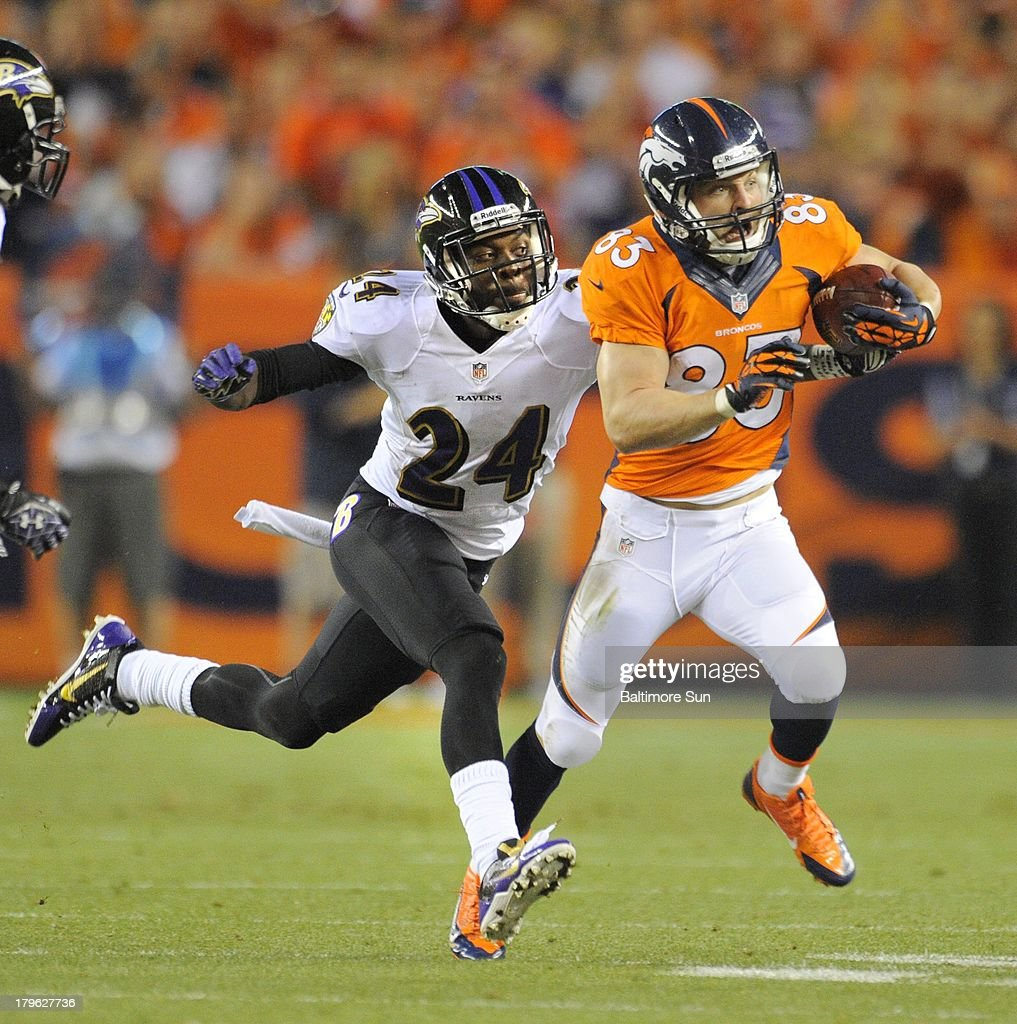 The Baltimore Ravens' Corey Graham (24) chases the Denver Broncos' Wes Welker in the first quarter on Thursday, September 5, 2013, at Sports Authority Field at Mile High in Denver, Colorado.