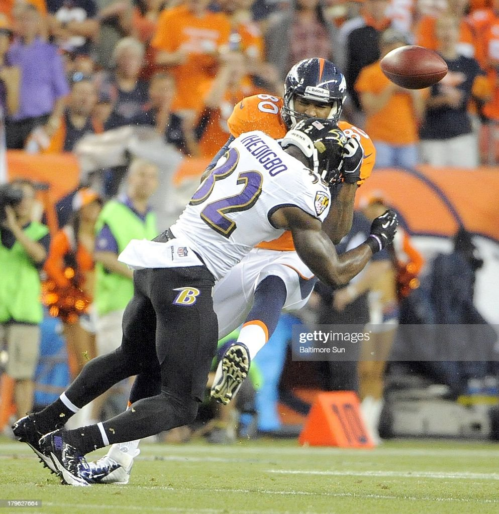 The Baltimore Ravens' James Ihedigbo (32) makes a hit on the Denver Broncos' Julius Thomas in the first quarter on Thursday, September 5, 2013, at Sports Authority Field at Mile High in Denver, Colorado.