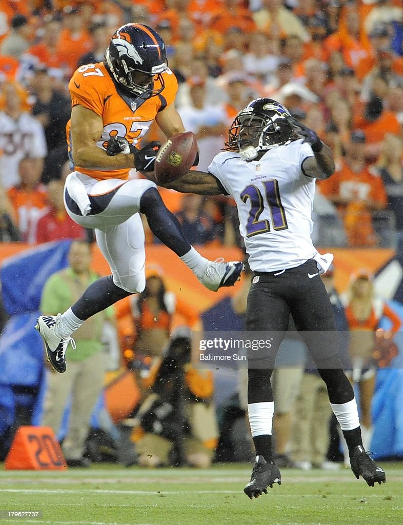 The Baltimore Ravens' Lardarius Webb (21) knocks the ball away from Denver Broncos wide receiver Eric Decker in the first quarter on Thursday, September 5, 2013, at Sports Authority Field at Mile High in Denver, Colorado.