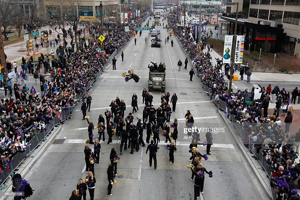 The Baltimore Ravens Super Bowl victory parade makes its way through the streets of Baltimore on February 5, 2013. The Ravens defeated the San Francisco 49's in the Super Bowl to win the NFL Championship in New Orleans on February 3. AFP PHOTO/Molly RILEY