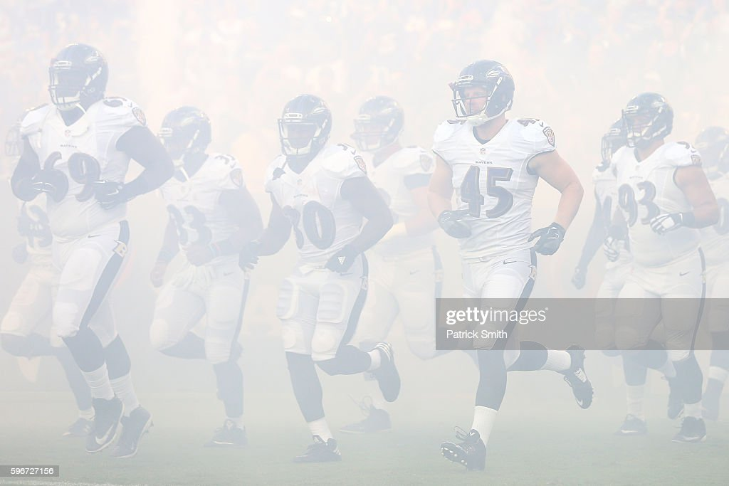 The Baltimore Ravens take the field before playing the Detroit Lions during the first half in their preseason game at MT Bank Stadium on August 27...