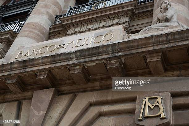 The Banco de Mexico headquarters building stands in Mexico City Mexico on Wednesday Aug 13 2014 Mexican policy makers lowered their 2014 growth...