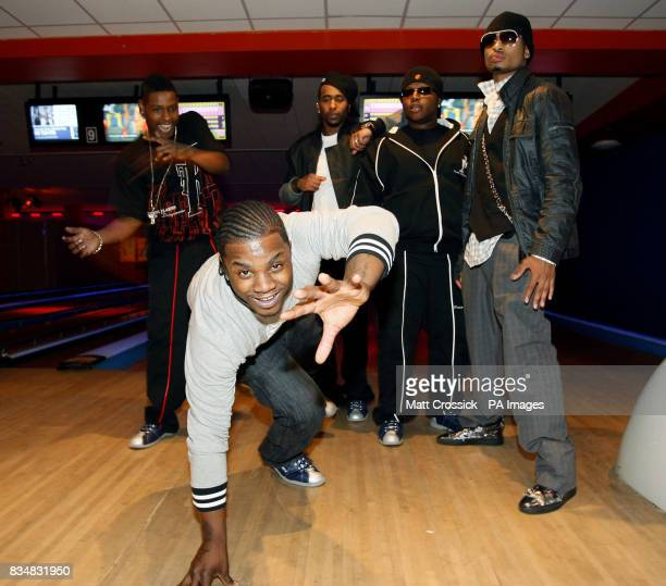 The band Day 26 Robert Curry Brian Andrews Willie Taylor Michael McCluney and Qwanell Mosley pose for photographs at the Queens Ice and Bowl in...