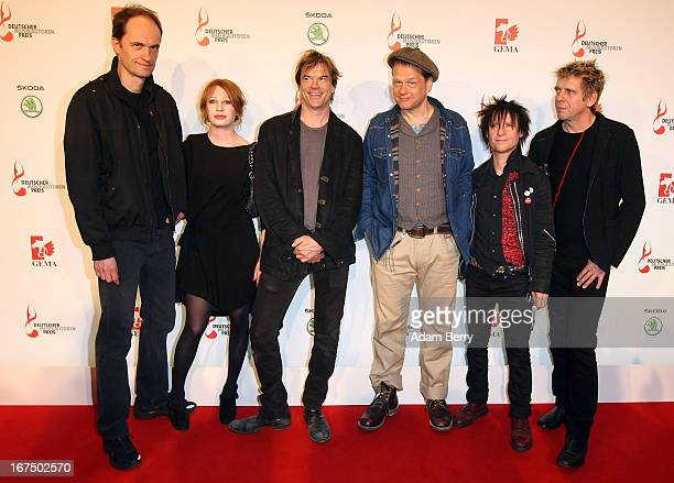 The band Die Toten Hosen arrives for the Deutscher Musikautorenpreis 2013 ceremony at the Ritz Carlton hotel on April 25 2013 in Berlin Germany The...